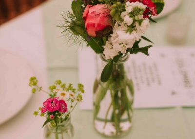 Accent flowers dotted along tables