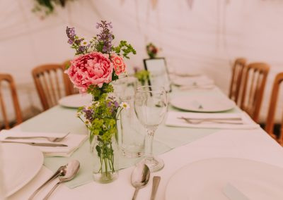 Long tables By the sea flowers